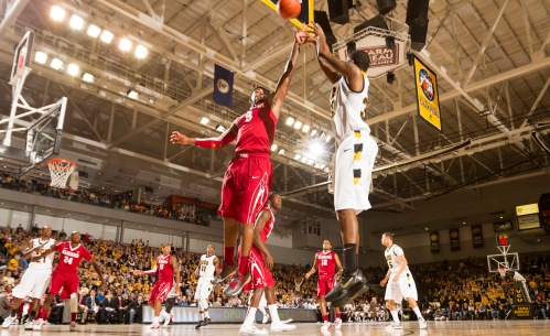 Senior Troy Daniels (pictured right, shooting) set a VCU single-game record with nine 3-pointers Saturday.
