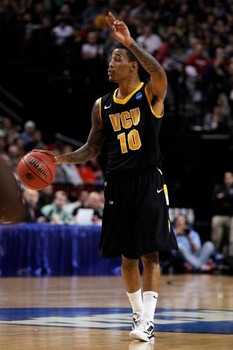 Senior point guard Darius Theus is averaging 8.4 points and 4.7 assists per game this season.