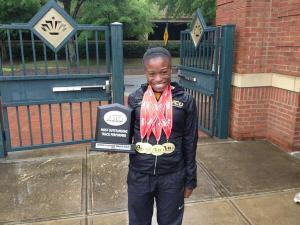Porter with her four gold medals from the A-10 Championship meet earlier this month.