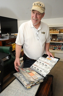 Inside his Richmond home, longtime VCU fan Mark Dalton oversees an impressive memorabilia collection.